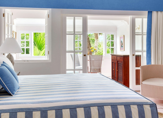 deluxe ocean suite with blue and white striped bedding