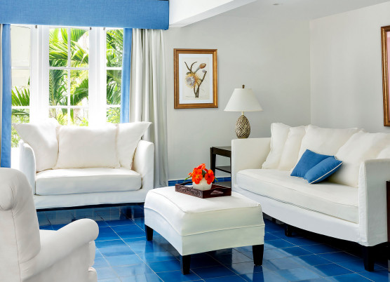hibiscus cottage living room with white furniture and blue flooring