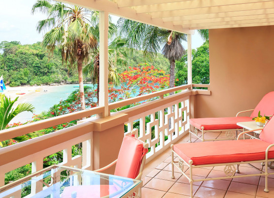 prime ministers penthouse suite balcony area with coral furniture overlooking beach