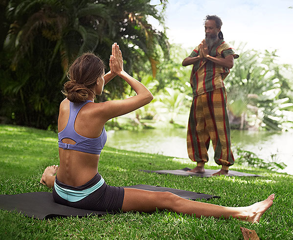 woman participating in yoga session on grass