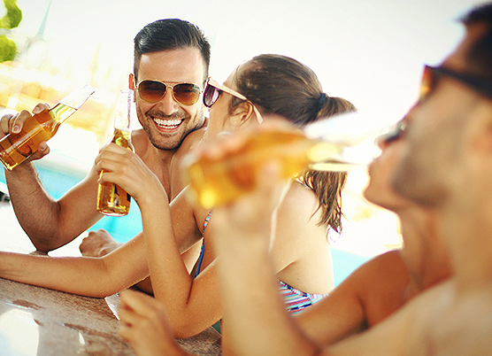 couples having drinks at a pool bar