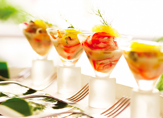 fish in a small clear martini glass with fork