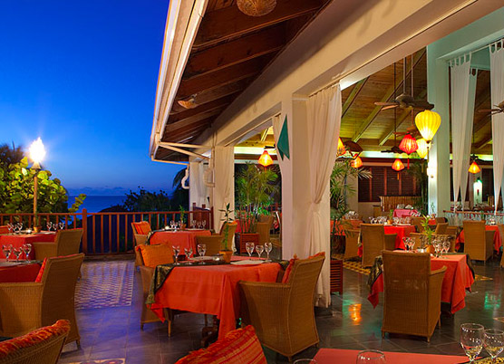 tables set for dinner outside at night