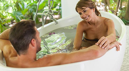 Lifestyle shot of couple in bath at Couples Tower Isle all inclusive resort