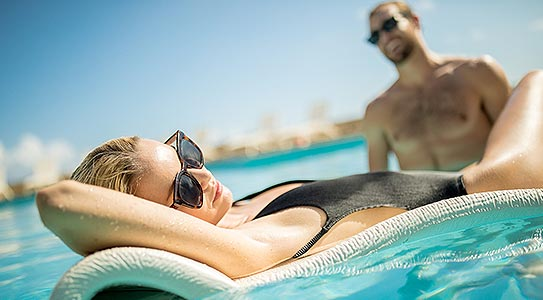 Lifestyle shot of couple in pool at Couples Tower Isle all inclusive resort