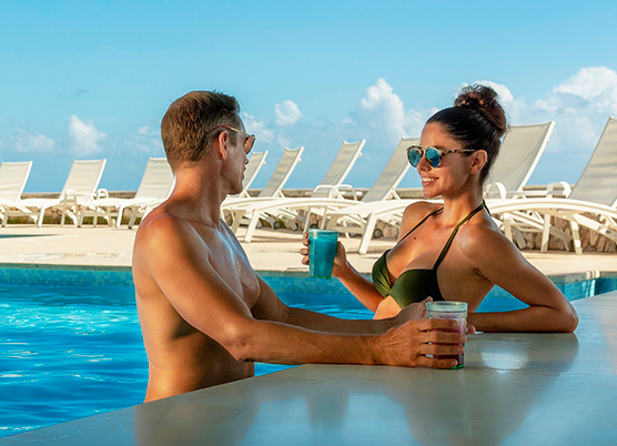 Lifestyle shot of couple in pool at Couples Swept Away all inclusive resort