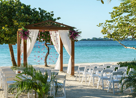 beach wedding ceremony with a gazebo altar