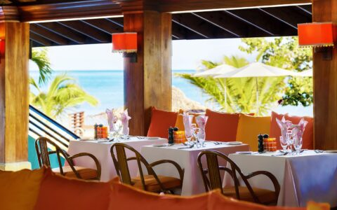 colorful outdoor dining area with a view of the ocean