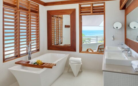 bathroom with white stand alone tub and wooden fixtures