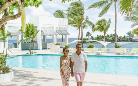 couple walking near the pool area