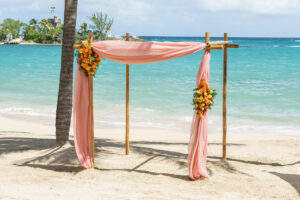 Couples Tower Isle Beach Wedding