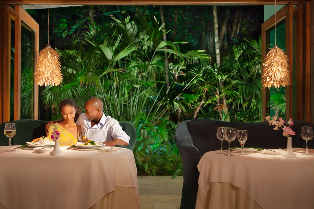 Couple enjoying dinner at a restaurant on their winter Caribbean holiday