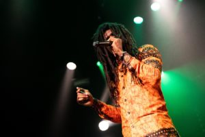 man performing reggae on stage